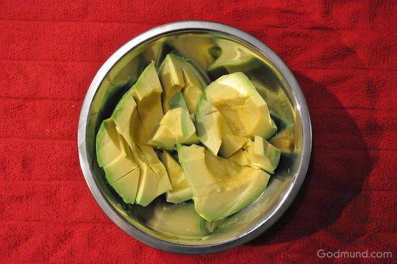 Sliced avocado on red towel  - Godmund