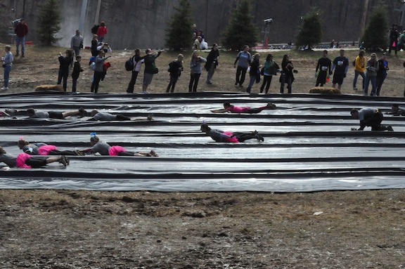Sliding down the mountain in tutus at tough mudder