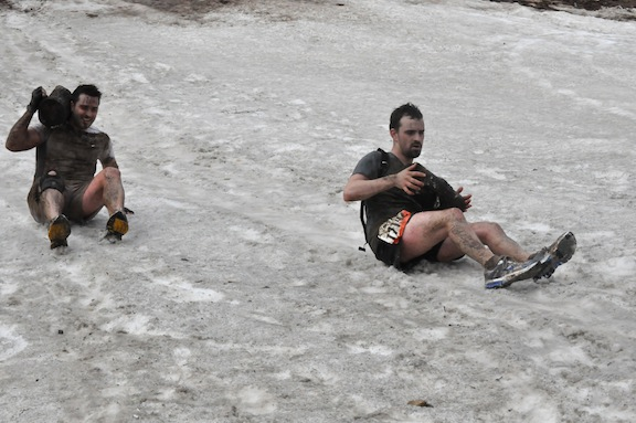 Sledding down the mountain with my log at ToughMudder PA 2011