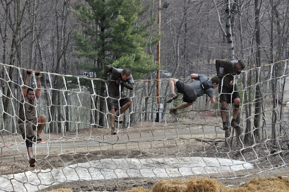 Climbing over the cargo nets at ToughMudder PA 2011