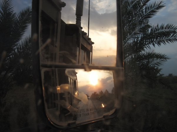 Rear view mirror shot from an up armored Humvee in Iraq