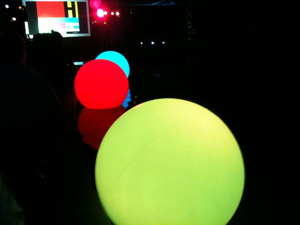 Floating color shifting globes at the Hirschorn