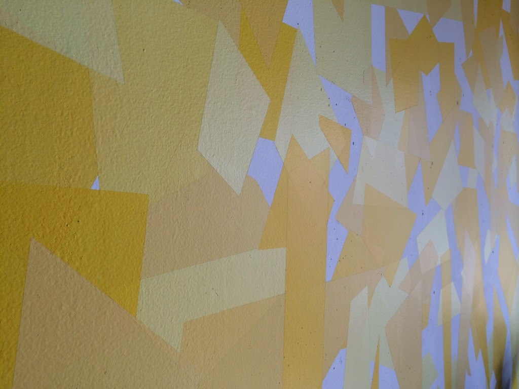 image of yellow fragmented feature wall in the living room