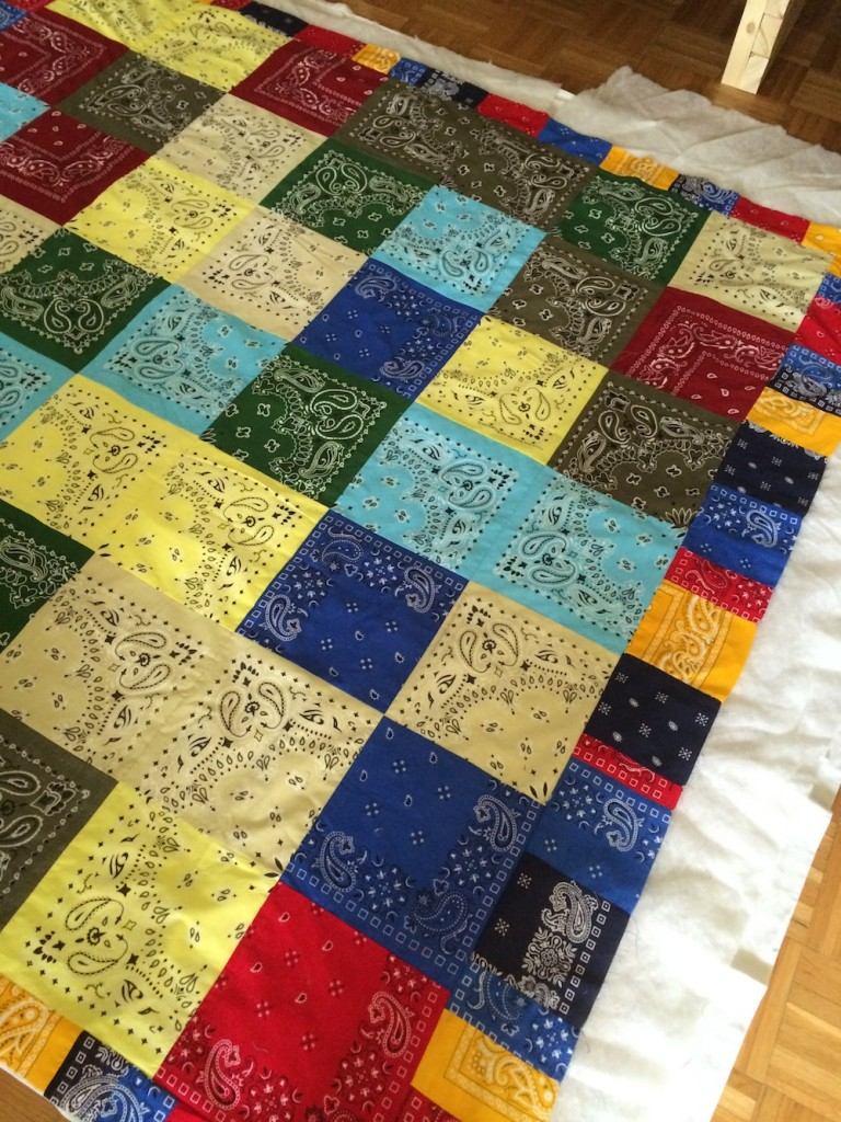 I put together this quilt of old handkerchiefs over the weekend.
